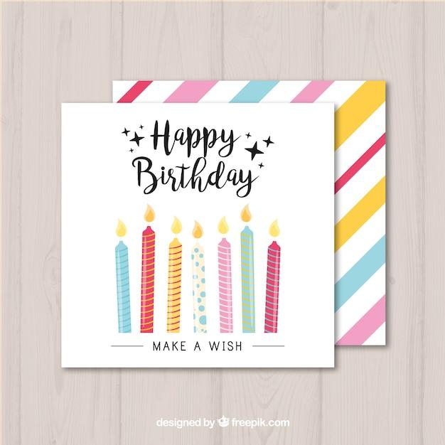 Tarjeta de cumpleaños con velas coloridas Vector Premium