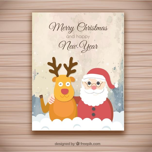 Tarjeta de felicitación de la Navidad con el fondo del grunge Vector Gratis