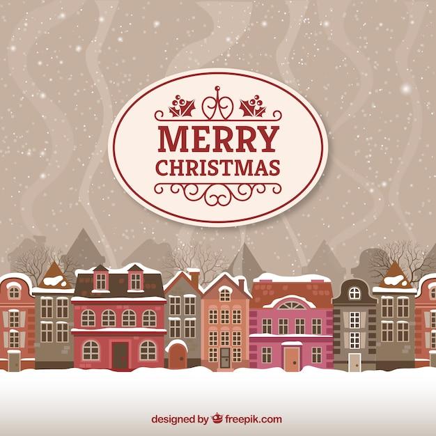 Tarjeta de la Feliz Navidad con paisaje urbano Vector Gratis