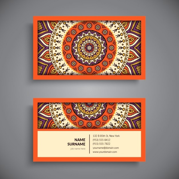 Tarjeta de visita naranja con un mandala Vector Gratis
