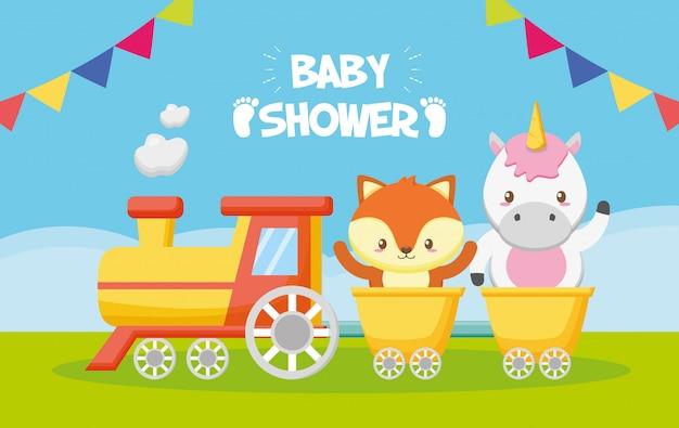 Tarjeta de unicornio y zorro en tren para baby shower vector gratuito