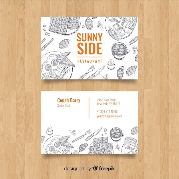 Tarjeta de visita de restaurante con elementos dibujados vector gratuito