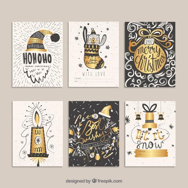 Tarjetas doradas navideñas en estilo dibujado a mano vector gratuito