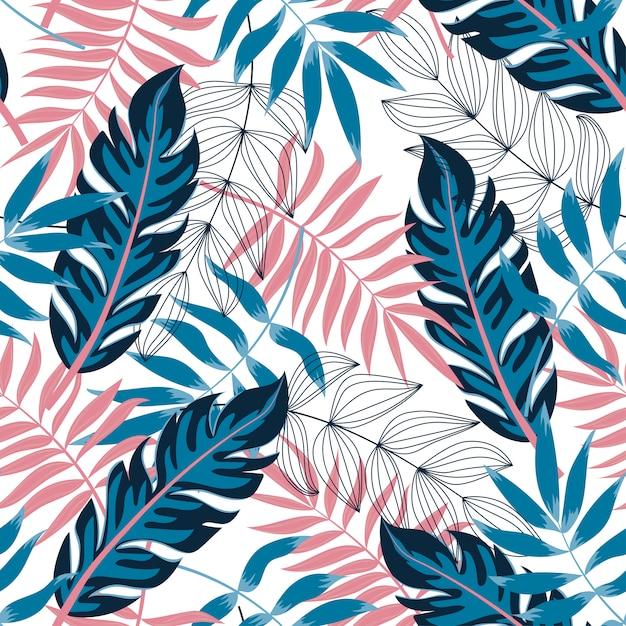 Tendencia de patrones sin fisuras con plantas y hojas tropicales Vector Premium
