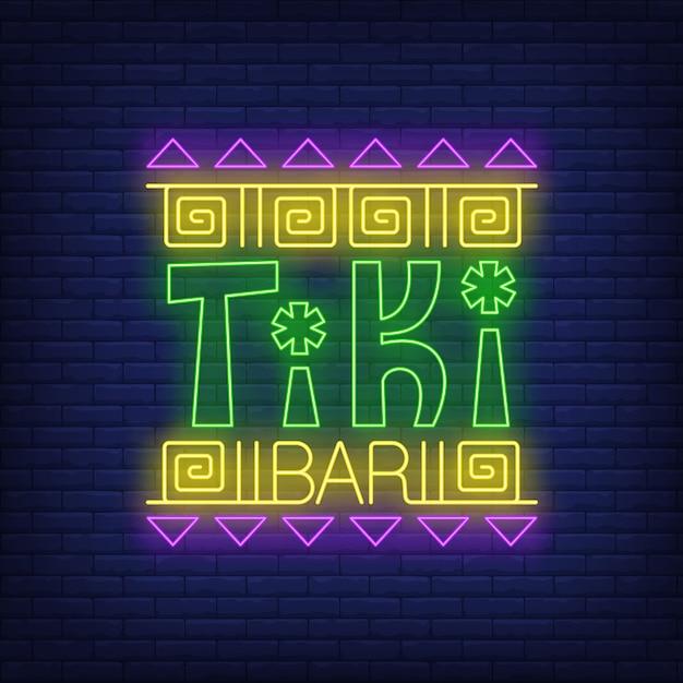Tiki bar texto de neón con adornos étnicos vector gratuito