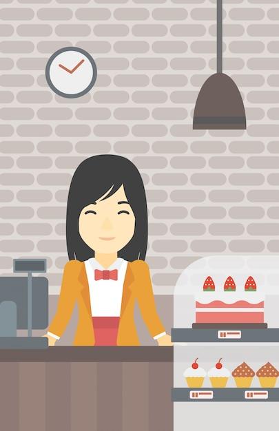 Trabajador de pie detrás del mostrador en la panadería. Vector Premium