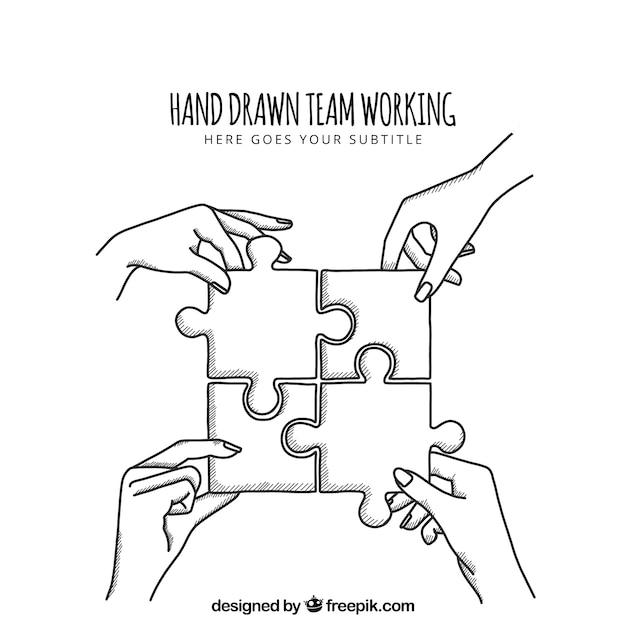 Trabajo en equipo a mano con puzle vector gratuito