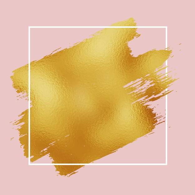 Trazo de pincel de hoja de oro sobre fondo rosa con borde blanco vector gratuito