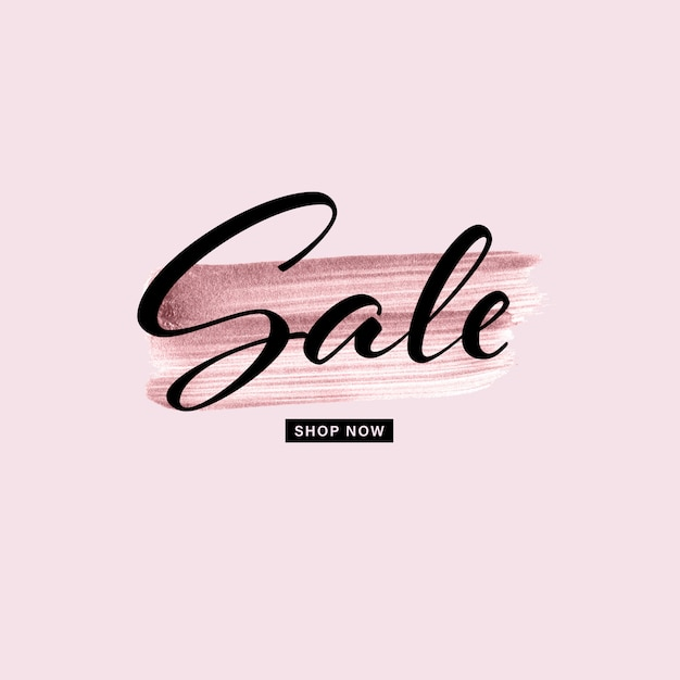 Trazo de pincel pintado a mano de oro rosa con texto de venta sobre fondo rosa. Vector Premium