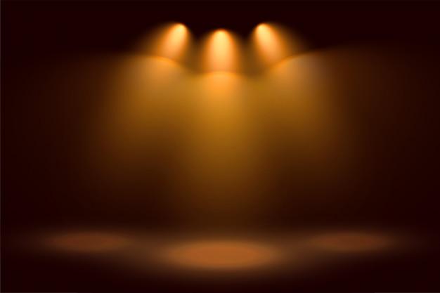 Tres focos dorados y fondo de escenario vector gratuito