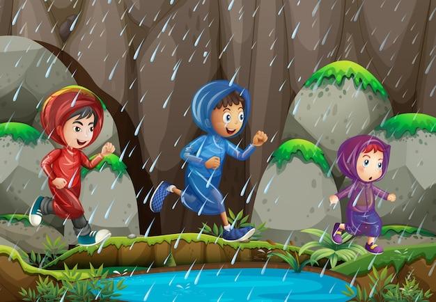 tres ni u00f1os bajo la lluvia