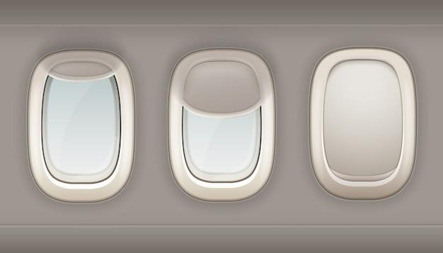 Tres ojos de buey realistas del avión de plástico blanco con cortinas de ventana abiertas y cerradas vector i vector gratuito