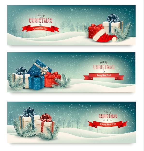Tres pancartas navideñas con regalos. Vector Premium