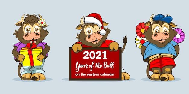 Tres toros en diferentes poses de cuerpo entero para decoraciones festivas o feliz año nuevo. Vector Premium