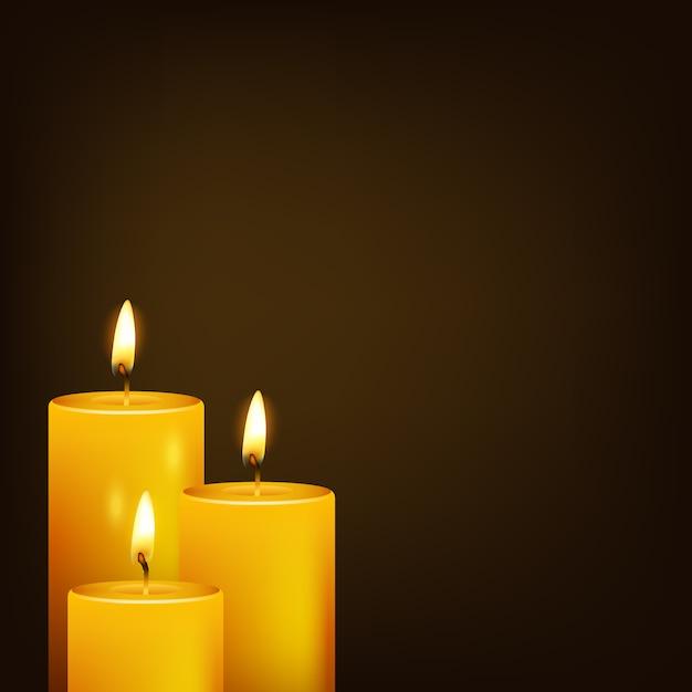 Tres velas y fondo oscuro Vector Premium