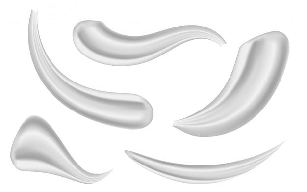 Varios trazos belleza cara cosmética crema blanca. Vector Premium