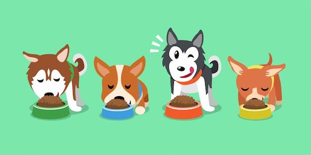 Vector de dibujos animados perros lindos con tazones de comida Vector Premium