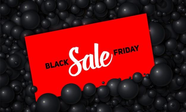 Vector ilustración de venta de viernes negro de tarjeta roja colocada en perlas negras o esferas vector gratuito