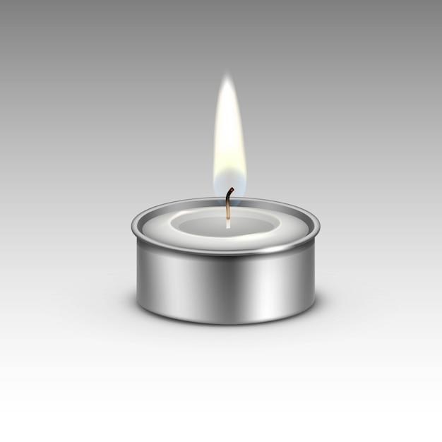 Vela en el candelabro de metal llama de luz de fuego. Vector Premium