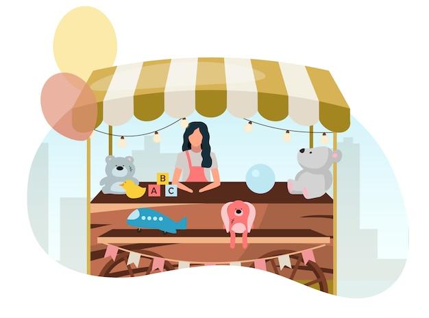 Vendedor de venta de juguetes en el mercado de la calle carro de madera ilustración plana. retro feria tienda puesto sobre ruedas. carretilla de comercio con juguetes artesanales. festival de verano, personaje de dibujos animados de vendedor de tienda al aire libre de carnaval Vector Premium