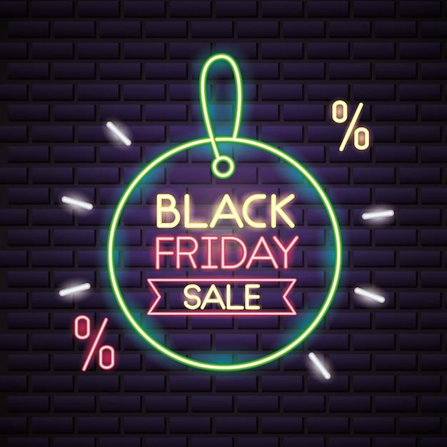 Venta de compras de viernes negro en luces de neón vector gratuito
