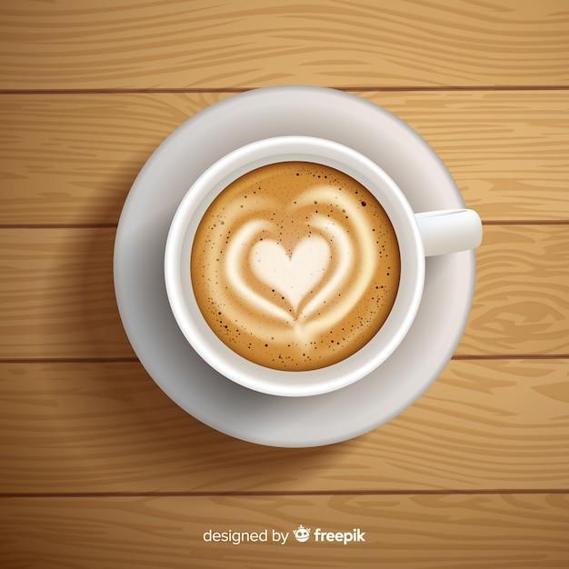 Vista aérea de taza de café con diseño realista vector gratuito
