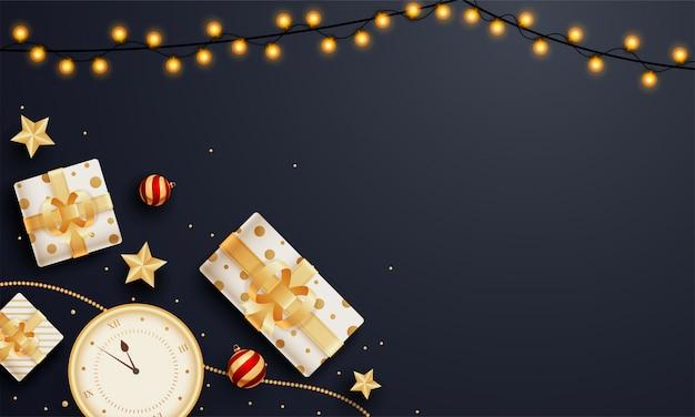 Vista superior de cajas de regalo con reloj de pared, estrellas doradas y guirnalda de iluminación decorada en negro con copyspace Vector Premium