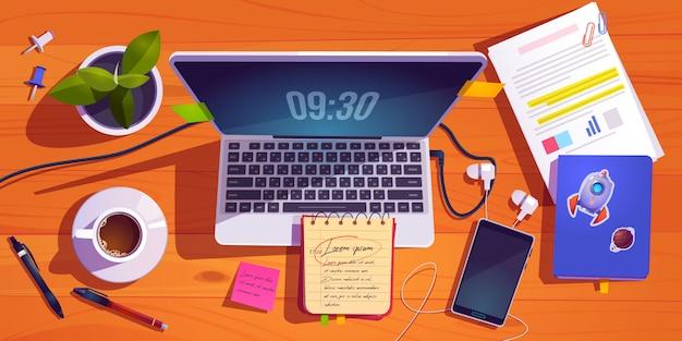 Vista superior del espacio de trabajo con laptop, papelería, taza de café y planta en mesa de madera. vector gratuito