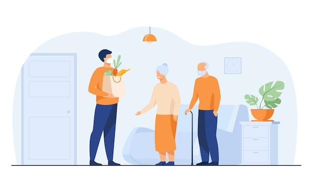 Voluntario entregando paquetes de comida para personas mayores aisladas ilustración vectorial plana. dibujos animados ancianos encuentro mensajero en máscara protectora. servicio de entrega y concepto de aislamiento. vector gratuito