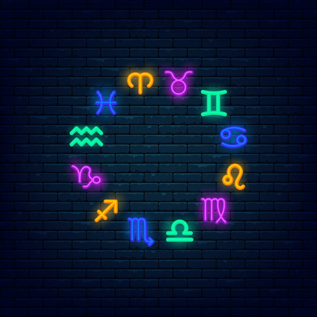 Zodiaco símbolos colorido banner de neón en pared de ladrillo Vector Premium