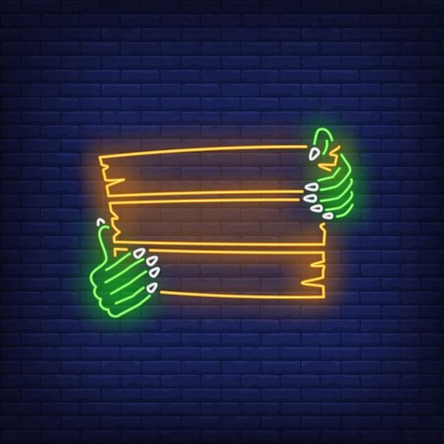 Zombie manos sosteniendo letrero de madera de neón vector gratuito