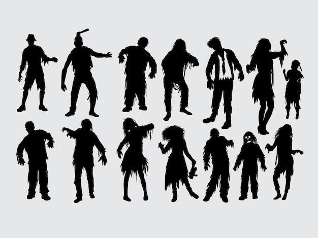 Zombie silueta de acción masculina y femenina Vector Premium