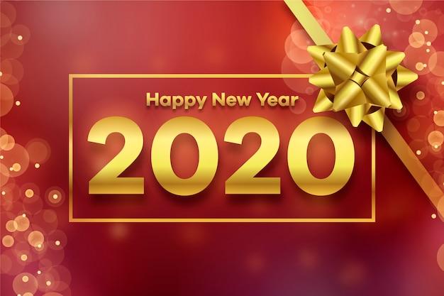 2020 goldener geschenkbogen und unscharfer hintergrund Kostenlosen Vektoren