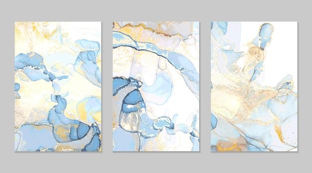 Abstrakte texturen aus hellblauem und goldenem marmor Premium Vektoren