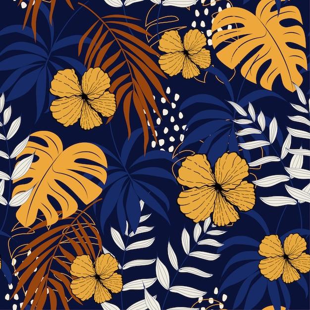 Abstraktes nahtloses muster des sommers mit bunten tropischen blättern und blumen auf dunkelheit Premium Vektoren