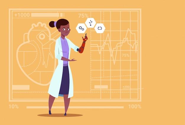 Ärztin working with robotic hand künstliche gliedmaßen medical clinics worker african american hospital Premium Vektoren