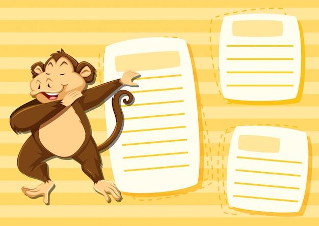 Affe auf leerer anmerkung mit copyspace hintergrund Kostenlosen Vektoren