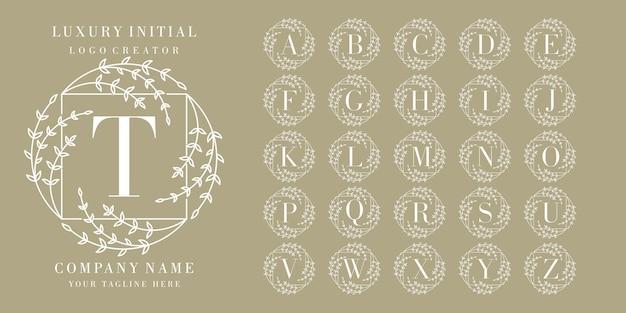 Anfängliches blumenrahmen-logo Premium Vektoren