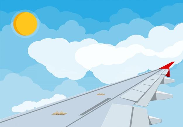 Ansicht des flügels des flugzeugs im himmel. Premium Vektoren