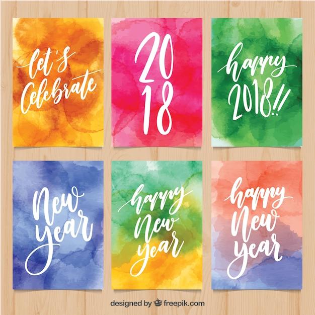 Aquarell neujahrskarten in hellen farben Kostenlosen Vektoren