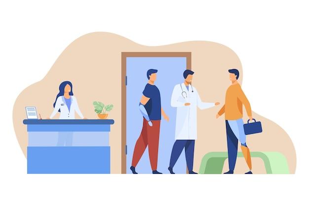 Arzt untersucht patienten mit künstlichen gliedmaßen. Kostenlosen Vektoren