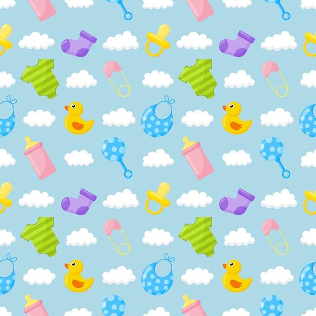 Babyspielzeug und kleidung symbole nahtlose muster. neugeborene elemente auf blau. Premium Vektoren