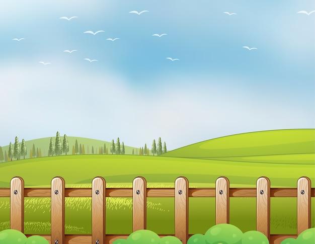 Bauernhof in der naturszene mit leerem hellblauem himmel Kostenlosen Vektoren