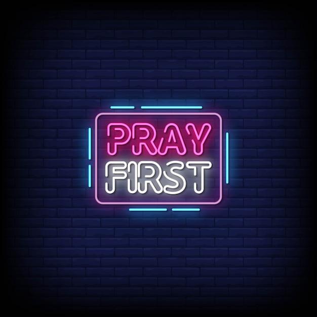 Beten sie zuerst neon signs style text Premium Vektoren