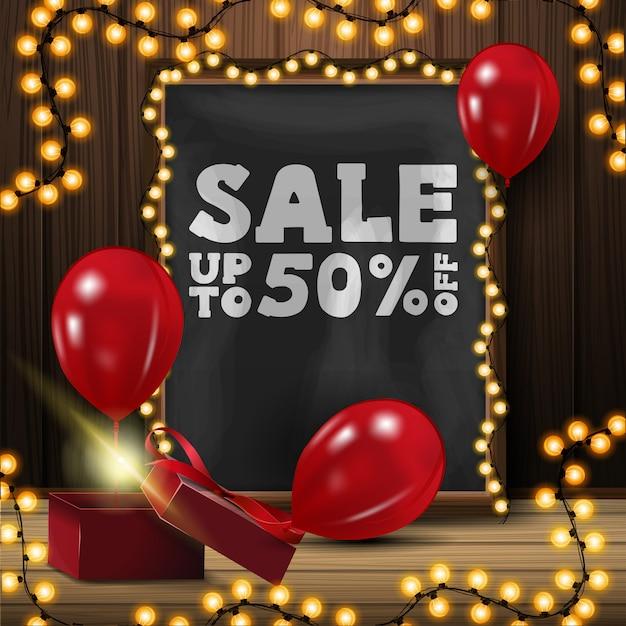 Bis zu 50% rabatt auf werbebanner mit kreidetafel, gelber girlande, geschenk und roten luftballons Premium Vektoren