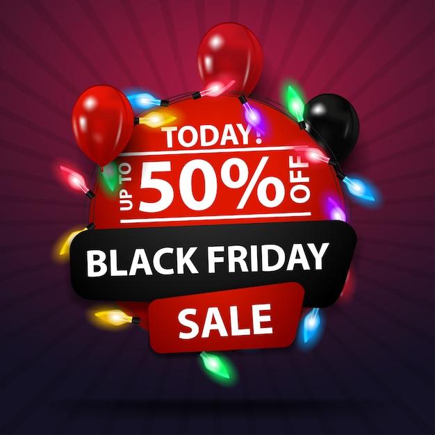 Black friday sale, bis zu 50% rabatt, rundes rabatt-banner mit girlande und luftballons Premium Vektoren