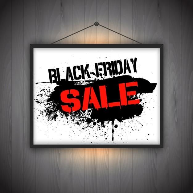 black friday verkauf hintergrund mit h ngenden bilderrahmen auf holzwand download der. Black Bedroom Furniture Sets. Home Design Ideas