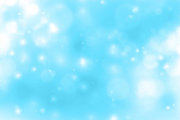 Blauer hintergrund mit leuchtendem funkelndem bokeh Kostenlosen Vektoren