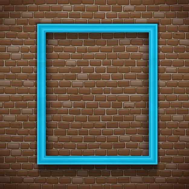 Blauer leerer bilderrahmen auf backsteinmauerhintergrund Kostenlosen Vektoren