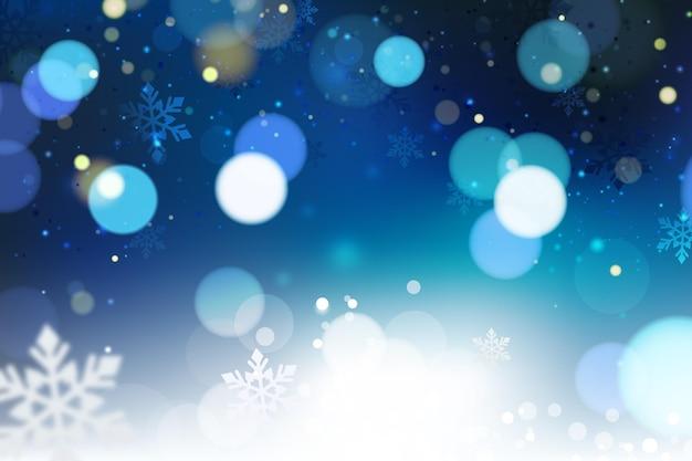 Blauer verschwommener winterhintergrund Kostenlosen Vektoren